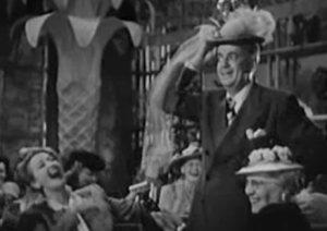 Tom Breneman tries on Hedda Hopper's hat in Breakfast In Hollywood