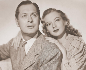 Robert Montgomery (Joe)  and Evelyn Keyes (Bette) in a promotional photo for Here Comes Mr. Jordan.
