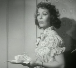 Loretta Young, concerned and holding a tray, in Cause For Alarm!