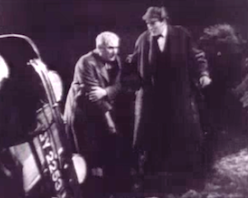 Watson (Ian Fleming) and Holmes (Arthur Wontner, in deerstalker cap) climb out of a wrecked car, in Murder at the Baskervilles.