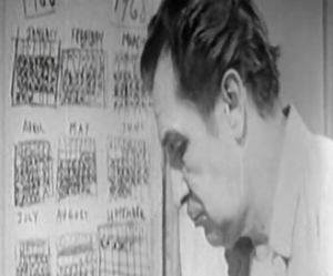 Dr. Robert Morgan (Vincent Price) looks down after marking another X on hand-drawn calendars in The Last Man On Earth.
