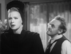 Short with round wire-rimmed glasses, Pop (Barry Fitzgerald) speaks to Judy (Betty Hutton) as she stares into space in The Stork Club.