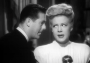 While performing, Judy (Betty Hutton) glances sideways at Danny (Don DeFore) when he speaks in her ear in The Stork Club.