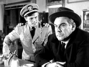 In a diner, Clint Reed (Richard Widmark, in military uniform), stands speaking intensely to Captain Warren (Paul Douglas), who sits at the counter staring into space.