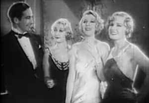 All in evening wear and smiling, Dey (David Manners) admires Schatzi (Joan Blondell), Jean (Ina Claire) and Polaire (Madge Evans).