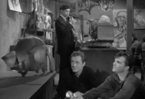 At the coffee house, Walter (Dick Miller) joins a beatnik admiring his sculpture of a cat with a knife sticking out of it.
