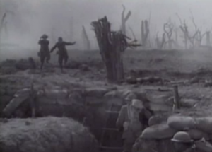 Tommy and Gilbert (Wheeler and Woolsey) run through a desolate battlefield toward a trench.