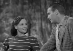 Standing beside him, Leslie (Paulette Goddard) smiles up at Rick (Douglas Fairbanks Jr.)