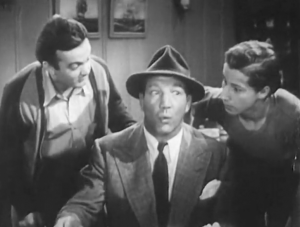 In his suit and hat, Butch (Maxie Rosenbloom) puckers his lips as Muggs (Leo Gorcey) and Danny (Bobby Jordan) watch from either side.