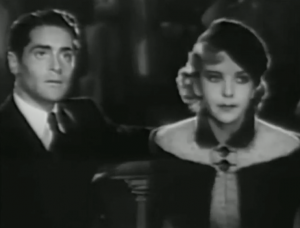 Philippe (Francis Lederer) and Monique (Ida Lupino) sit awkwardly beside each other.