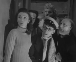 Bobbie (Googie Withers) with long dark hair and a sweater, Arthur (Arthur Askey) in a captain's hat and a scarf and bearded Jerry (Moore Marriott) stare ahead and up, startled with two other women behind them.