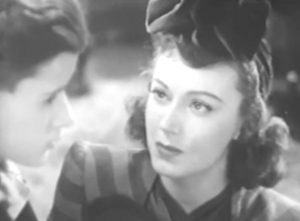 Mary (Fay Wray) looks at Billy (Schuyler Standish), who's staring into space in profile.