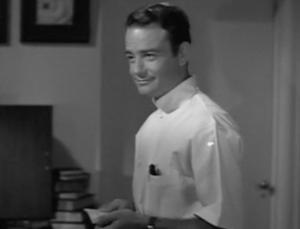 Kildare (Lew Ayres) smiles in his white smock.