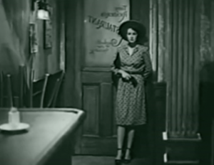 "Judy (Rosemary Lane) pauses, leaning against a front door. In reverse on the window of the door, letters say, ""Tony Rocadero's Restaurant""."