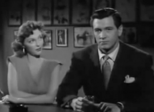 At a bar, Roy (Rock Hudson) stares into space while Pat (Julie London) looks at him.