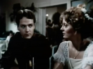 Sitting beside each other at a dance, Andy (David Huffman) and Ailie (Susan Sarandon) look at each other.