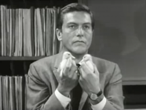 In the office, Rob (Dick Van Dyke) frowns as he holds two baby ducks.