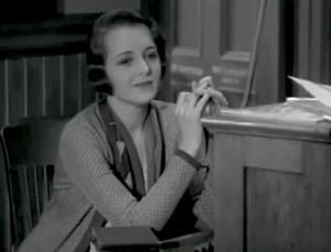 Mary (Mary Astor) gazes wistfully into space while sitting at her switchboard at work.