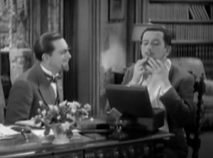 Dickie speaks with Zero (both Edward Everett Horton), who tries on a goatee to match Dickie's in a mirror.