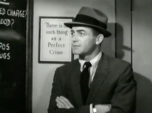 "In a suit and hat, Charlie (Mark Stevens) stands by framed text, which says ""There is no such thing as a Perfect Crime""."